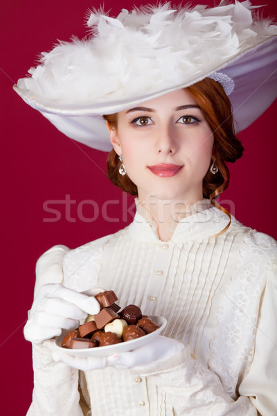 photo of beautiful young woman in vintage dress with plate full  Stock photo © Massonforstock