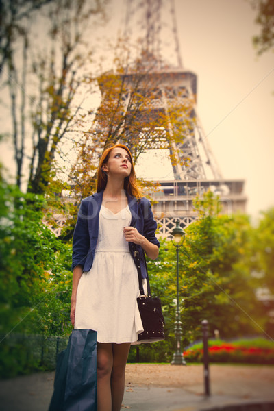 beautiful young woman with shopping bag on the Eiffel Tower back Stock photo © Massonforstock