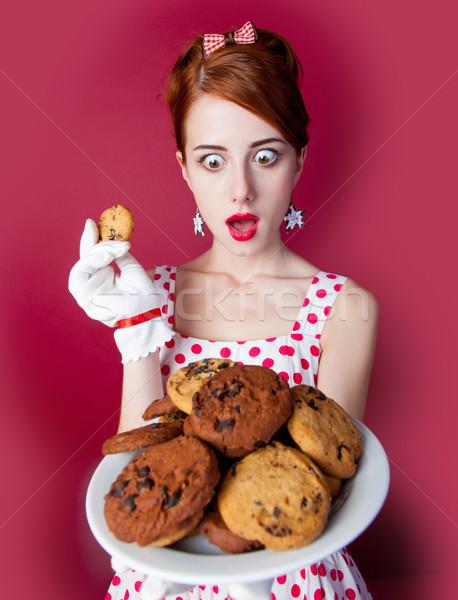 Photo belle jeune femme vintage pointillé robe Photo stock © Massonforstock