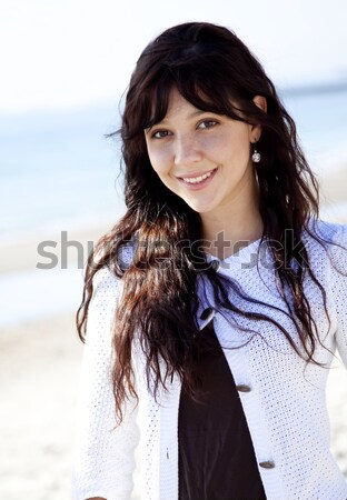 Pretty young woman with standing on beach  Stock photo © Massonforstock