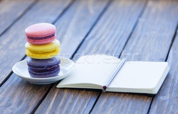 Macarons piccolo notebook tavolo in legno texture alimentare Foto d'archivio © Massonforstock
