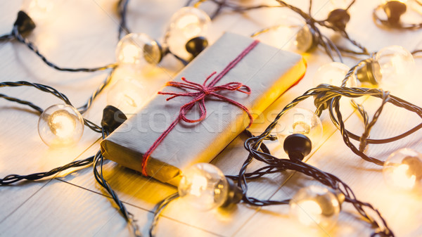 Christmas gift and fairy lights Stock photo © Massonforstock