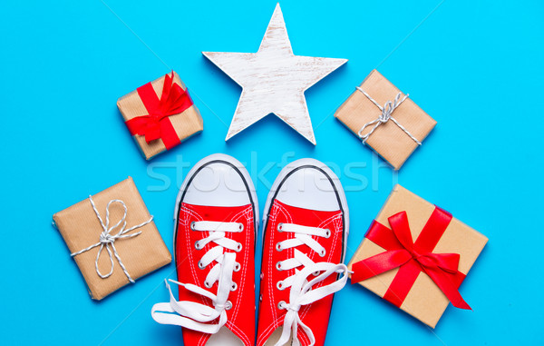 big red gumshoes, star shaped toy and beautiful gifts on the won Stock photo © Massonforstock