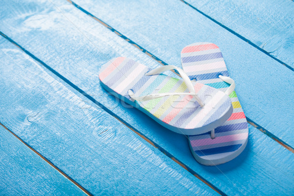 photo of colorful sandals on the wonderful blue wooden backgroun Stock photo © Massonforstock