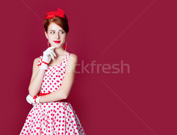 photo of beautiful young woman in vintage dotted dress on the wo Stock photo © Massonforstock