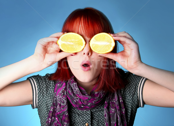 Chill girl in scarf keep lemon instead of eye  Stock photo © Massonforstock