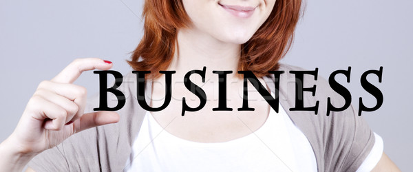 Stock photo: redhead businesswoman show abstract word