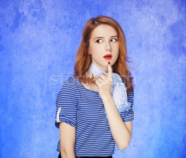 Surprised american redhead girl in suglasses. Stock photo © Massonforstock