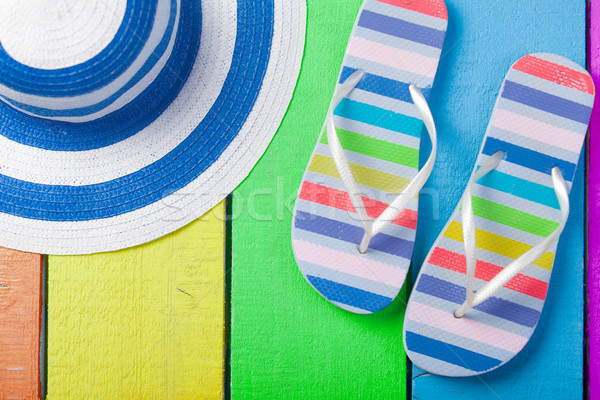 colorful sandals and hat on the wonderful colorful wooden backgr Stock photo © Massonforstock