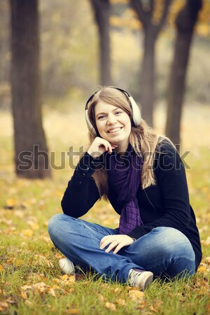 Portrait of red-haired girl in the autumn park.  Stock photo © Massonforstock