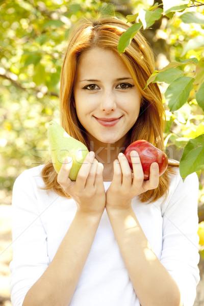Belo jovem mulher em pé apple tree Foto stock © Massonforstock