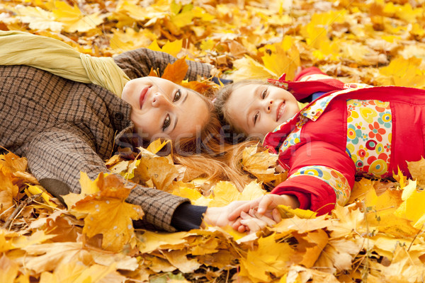 Mother and daughter in autumn yellow park Stock photo © Massonforstock