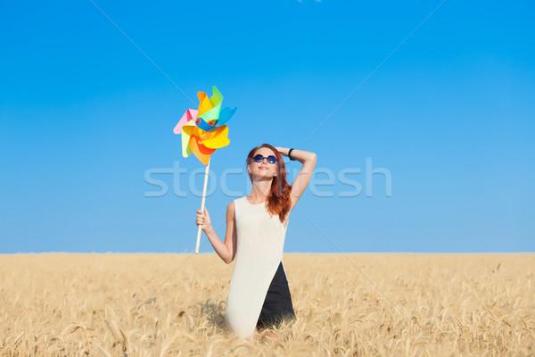 Abito bianco vento ragazza giocattolo campo di grano Foto d'archivio © Massonforstock