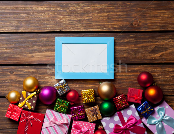 Blue photo frame and christmas gifts  Stock photo © Massonforstock