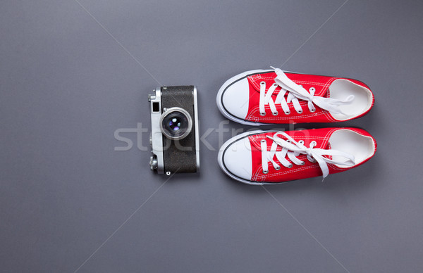 red gumshoes and retro camera  Stock photo © Massonforstock