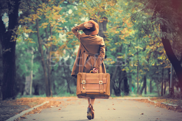 photo of beautiful young woman with suitcase on the wonderful au Stock photo © Massonforstock