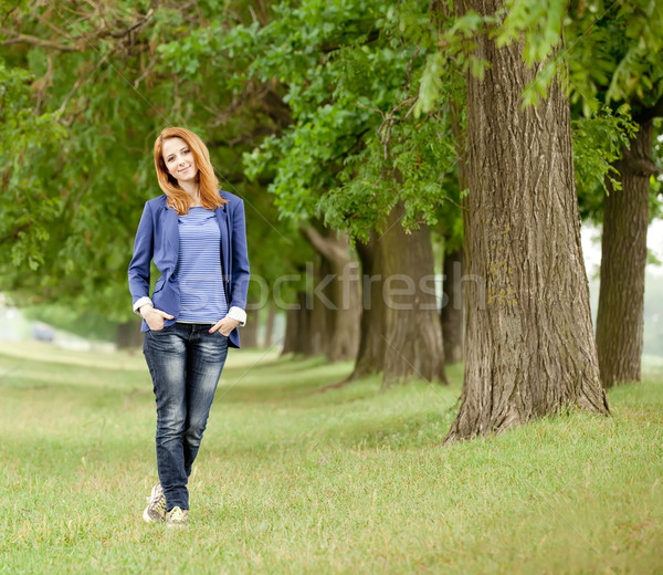 Young fashion girl at spring outdoor. Stock photo © Massonforstock