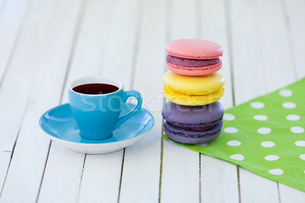 Cup of coffee and macarons on polka dot napkin Stock photo © Massonforstock