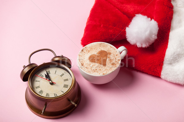 Cup of coffee and Santas hat with alarm clock  Stock photo © Massonforstock