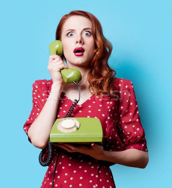 Mädchen roten Kleid grünen wählen Telefon überrascht Stock foto © Massonforstock