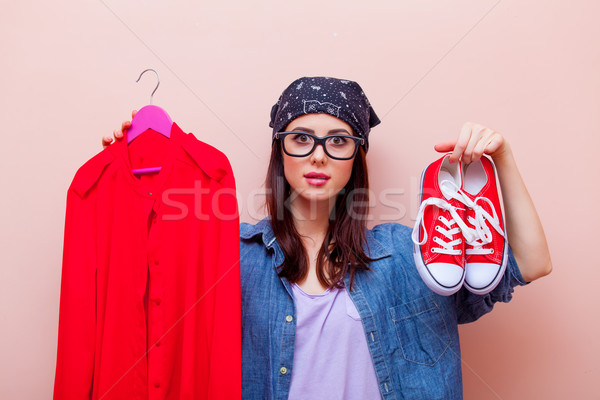 portrait of a young woman with clothes and gumshoes Stock photo © Massonforstock