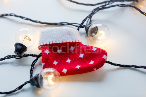 Fairy lights and christmas sock  Stock photo © Massonforstock