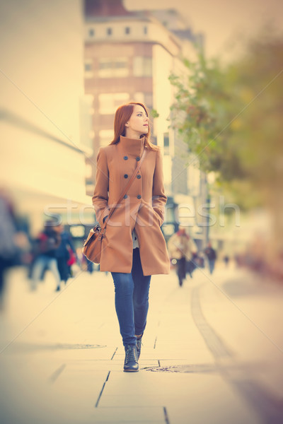 photo of beautiful young woman on one of the streets exploring t Stock photo © Massonforstock