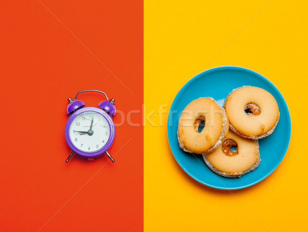 photo of alarm clock and cookies on the wonderful colorful backg Stock photo © Massonforstock