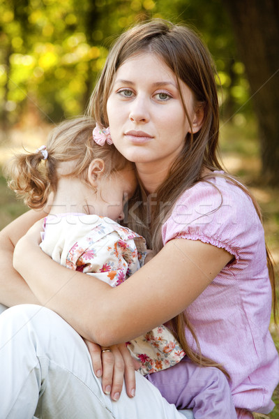 Stock photo: Sad little girl and mother in the park