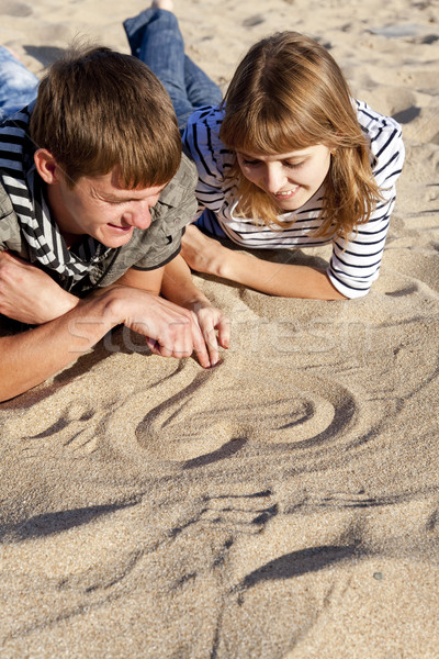 People drawing heart at sand Stock photo © Massonforstock