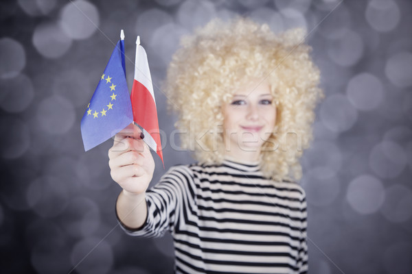 Beautiful girl with ringlets show European Union and Poland flag Stock photo © Massonforstock