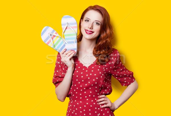 girl in red dress with flip flops  Stock photo © Massonforstock