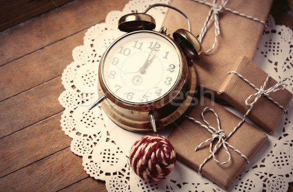 gifts, ball and clock on napkin Stock photo © Massonforstock