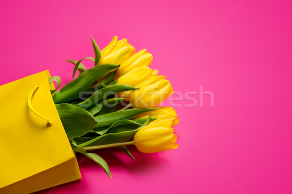 bunch of beautiful yellow tulips in cool yellow shopping bag on  Stock photo © Massonforstock