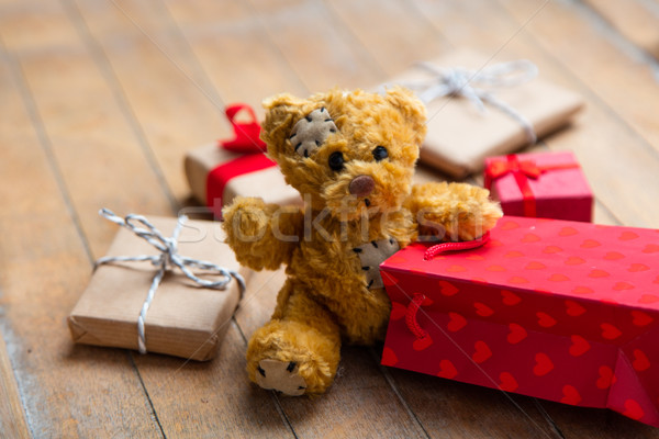 cute gifts, teddy bear and cool red shopping bag on the wonderfu Stock photo © Massonforstock