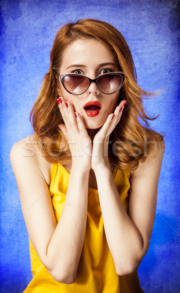American redhead girl in sunglasses. Photo in 60s style. Stock photo © Massonforstock