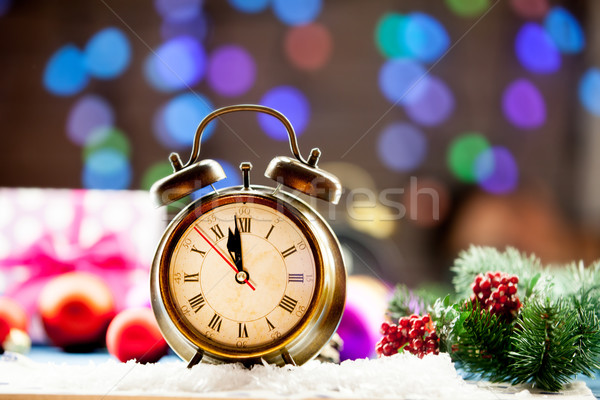 Vintage clock and Christmas lights Stock photo © Massonforstock