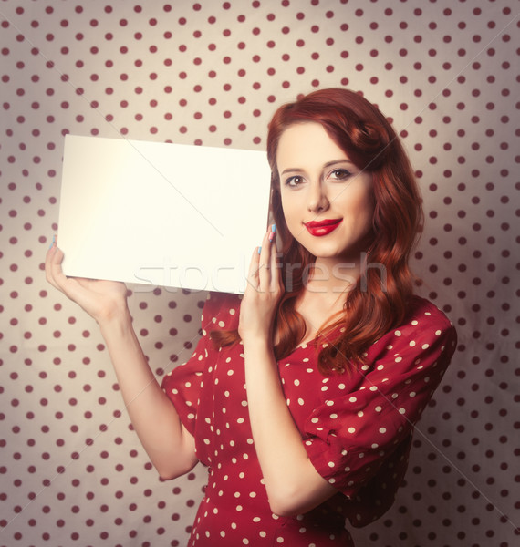Portrait of a redhead girl with white board  Stock photo © Massonforstock