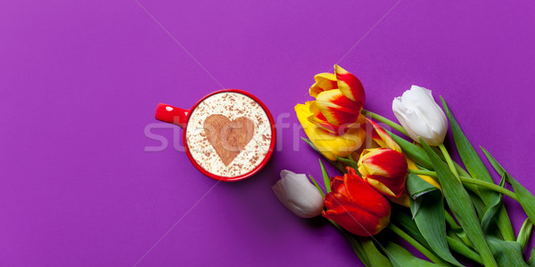 Beautiful bouquet of tulips and cappuccino Stock photo © Massonforstock