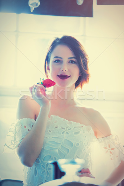 beautiful young woman standing near the window in the luxury roo Stock photo © Massonforstock