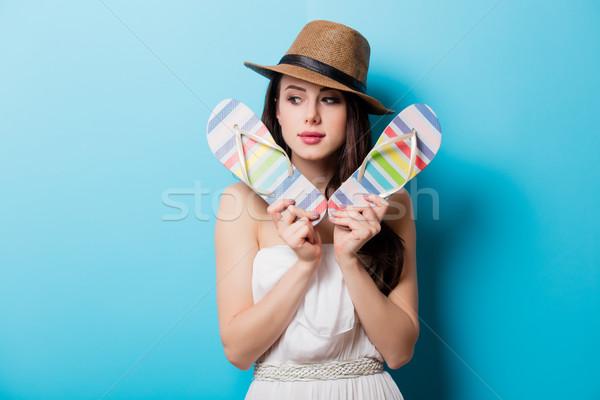 Gyönyörű fiatal nő színes szandál áll csodálatos Stock fotó © Massonforstock