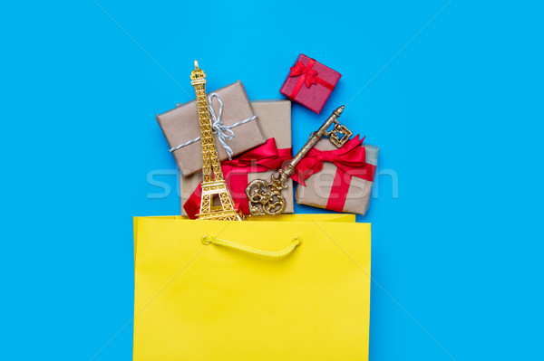 beautiful eiffel tower shaped toy, key and gifts in shopping bag Stock photo © Massonforstock