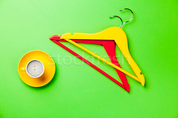 photo of cup of coffee and colorful hangers on the wonderful gre Stock photo © Massonforstock