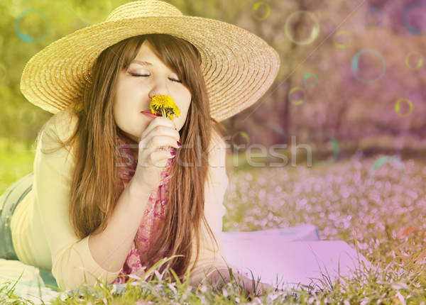 Beautiful brunette girl in hat at the park. Photo in multicolor  Stock photo © Massonforstock