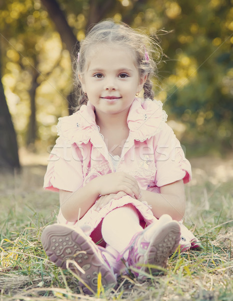 Stock photo: Cute little girl at outdoor in fall.
