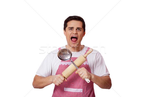 Gotowania człowiek sprzęt kuchenny biały obiedzie dżinsy Zdjęcia stock © Massonforstock