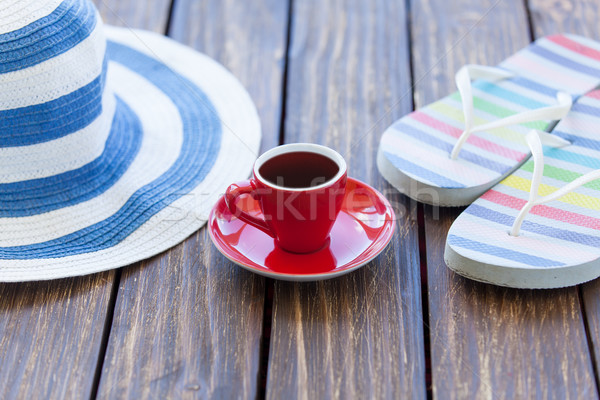 Csésze kávé kalap papucs fa asztal otthon Stock fotó © Massonforstock