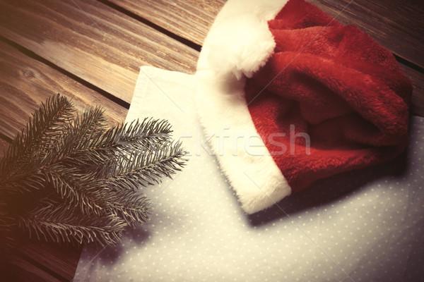 Santas hat and branch  Stock photo © Massonforstock