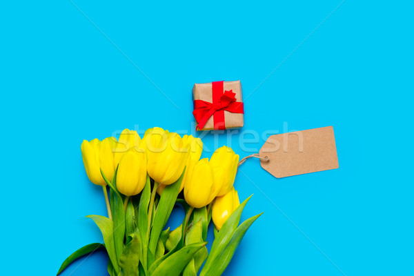 bunch of yellow tulips, price tag and beautiful gift on the wond Stock photo © Massonforstock