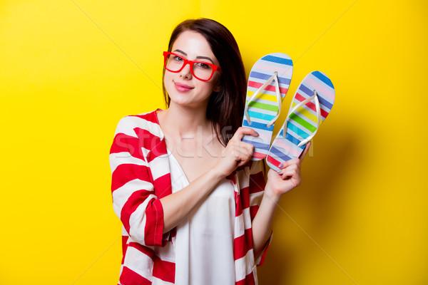 Mooie jonge vrouw kleurrijk sandalen permanente prachtig Stockfoto © Massonforstock